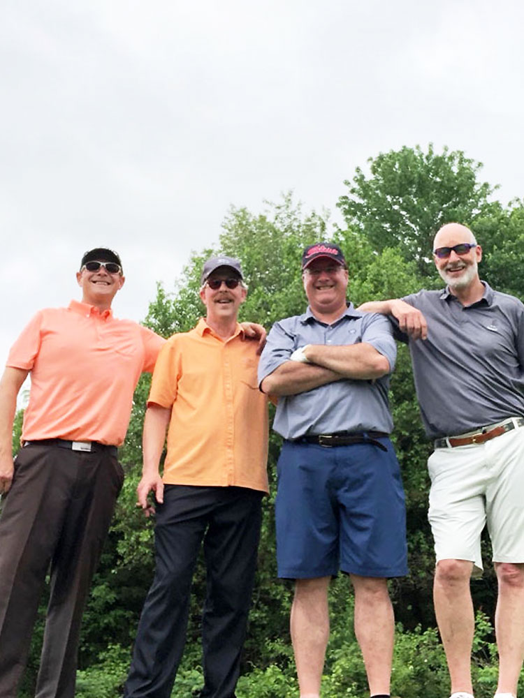 Iron Horse Cigar Depot Charity Golf tournament participants with owner Roy Brown